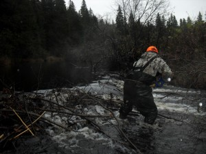 Tyler Coughlan notches a beaver dam on the Cains